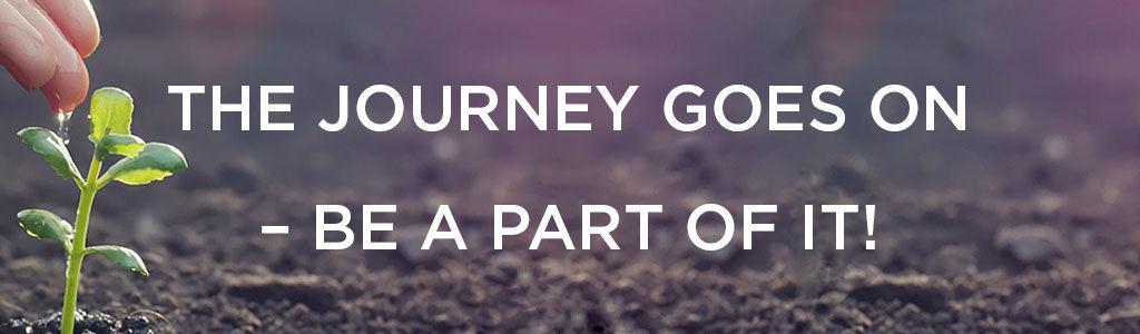 Ein Setzling mit dem Text The Journey goes on - sei dabei