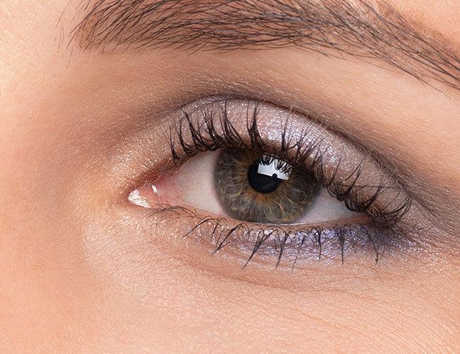 An eye with blue eyeshadow